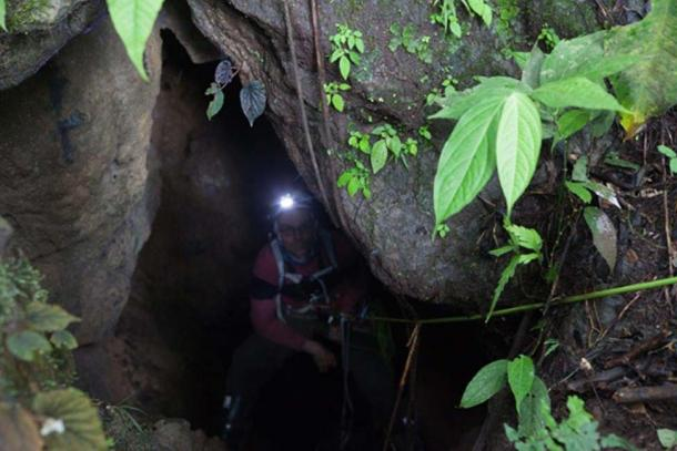 John in one of the cave entrances.