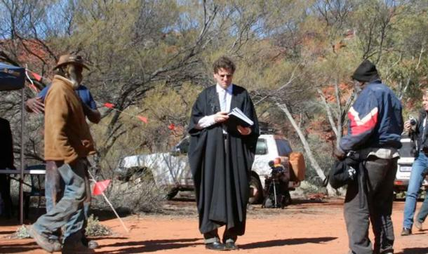 (Then) Justice Robert French at the Birriliburu Native Title determination in 2008 presenting senior custodians with a statement of the determination. Jo McDonald, Author provided