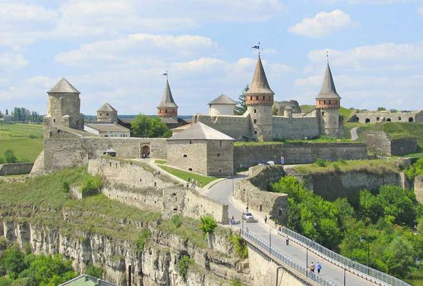 Seven of the Kamianets-Podilskyi castle's original twelve towers dominate over the surrounding Smotrych River canyon landscape.