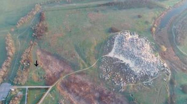 Kamyana Mohyla I (arrow) and the Kamyana Mohyla stone mound, viewed from the south.