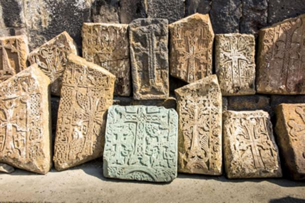 Khachkars have a large central cross that is surrounded by small pagan designs. (rparys / Adobe Stock)