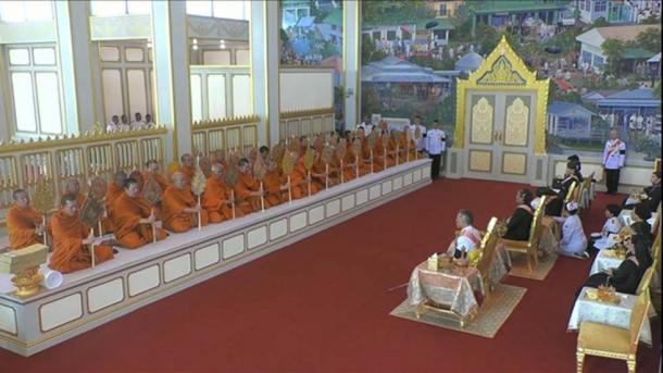 King Maha Vajiralongkorn presides over a merit-making ceremony for the Royal Relics and Ashes which includes giving alms to senior monks.