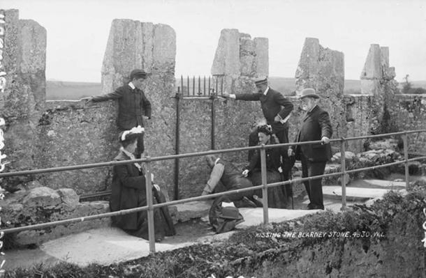 Kissing the Blarney Stone, 1897. National Library of Ireland. (Public domain)