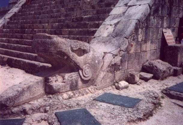 Kukulkan's head at the base of the west face of the northern stairway of El Castillo, Chichen Itza.