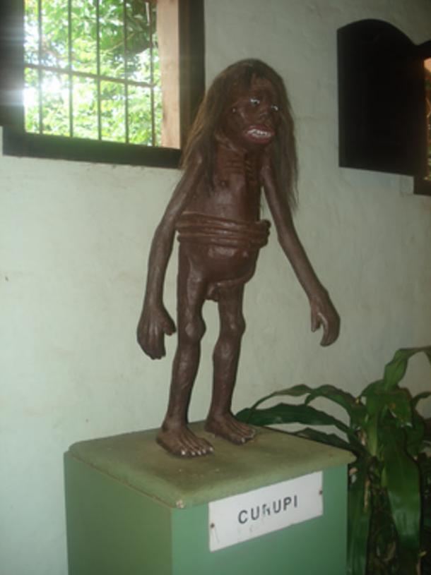Kurupi with his penis wrapped around his waist