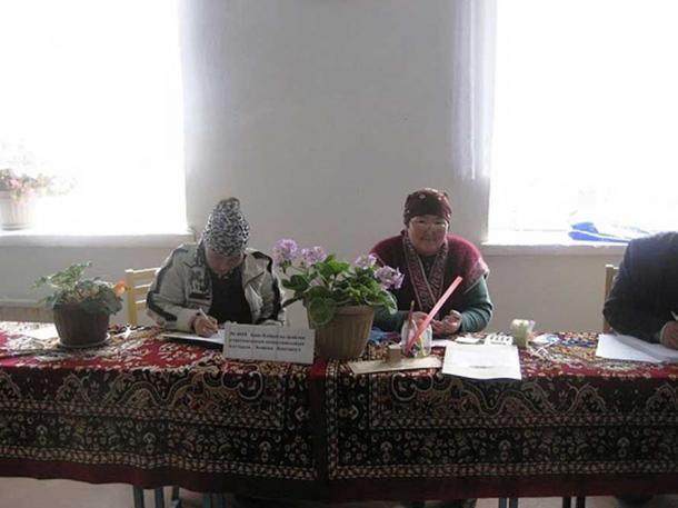 Kyrgyz Election Volunteers in 2010. Some have said the timing of this reburial—on the eve of an October 15 presidential election—indicates the influence of superstitions have had on the country's politics in the past.