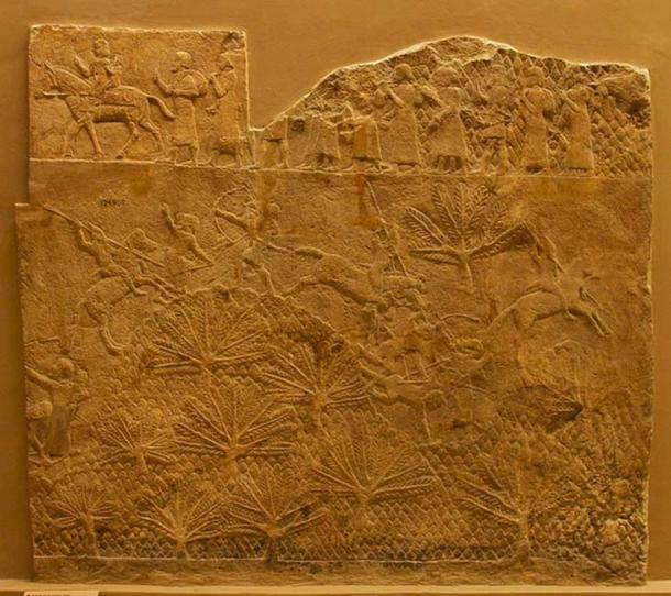 Part of the Lachish Relief, British Museum. Battle scene, showing Assyrian cavalry in action. Above, prisoners are led away.