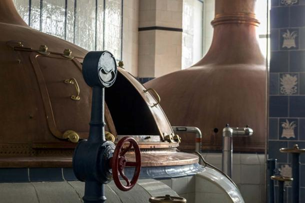 Large fermentation vats used in the traditional way of making beer. (malajscy / Adobe)