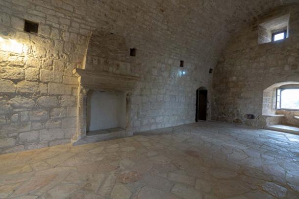 Large hall on the second floor of Kolossi Castle. Above the fireplace is the coat-of-arms of the Magnc dynasty with the characteristic fleur-de-lis.