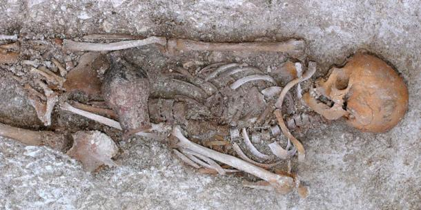 For comparison, this Late Roman burial from Boscombe Down, Wiltshire. The small drinking vessel placed in the grave had probably contained wine for the journey to the Underworld. The York burial was found only with the gold mouth plaque and a fake silver coin. (Image: Wessex Archaeology CC BY NC-SA 2.0)