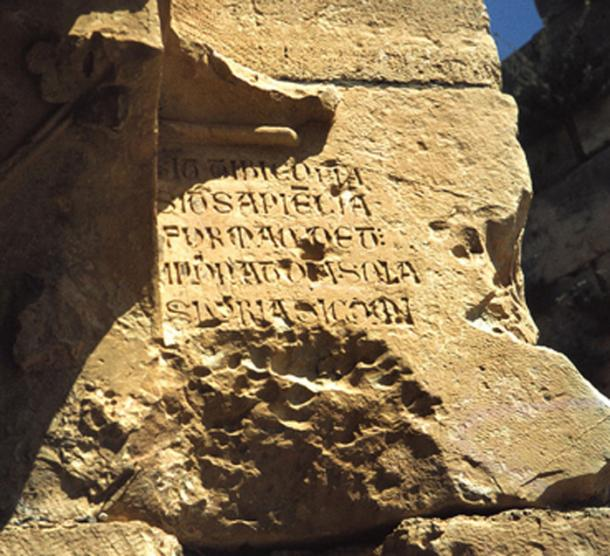 The Latin inscription.