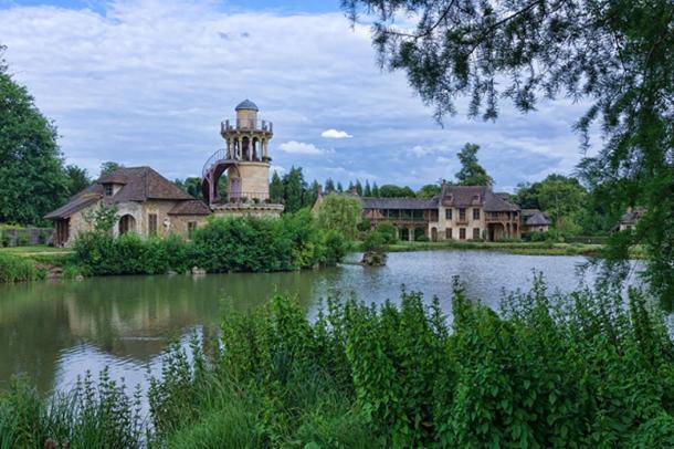Le hameau de la reine by the artificial lake in the gardens of the Petit Trianon.