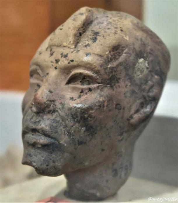 Limestone or calcite head of a statuette, possibly Pharaoh Aye – believed by some to have been Nefertiti's father. The royal uraeus would have probably been added after completion. Egyptian Museum, Cairo.