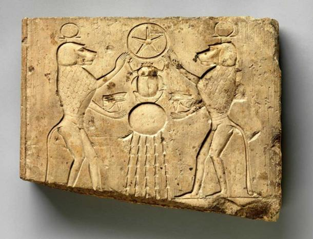 Limestone relief panel showing two baboons offering the wedjat eye to the sun god Khepri, who holds the Underworld sign. Late Period–Ptolemaic Period. Metropolitan Museum of Art, New York.