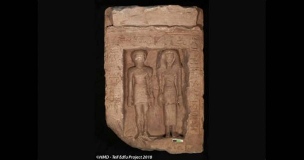 Limestone stela showing a man and woman standing next to each other, which shows signs of having been defaced. (Tell Edfu Project)