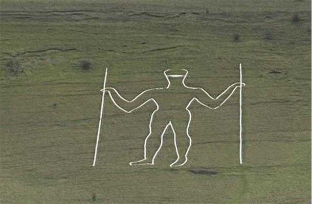 The Long Man of Wilmington temporarily defaced with the addition of a painted facemask. (@Jeremy_Christey)