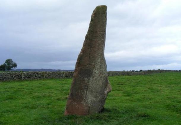 "Long Meg, a 12.5-foot (3.8-meter) high monolith of red sandstone standing about 109 yards (25 meters) from the circle of the ""daughter"" stones."