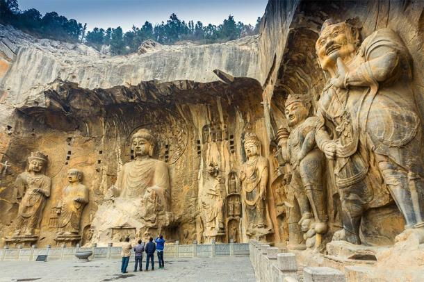 Longmen Grottoes with Buddha figures in one of the ancient capitals of China: Luoyang. (SANCHAI / Adobe stock)