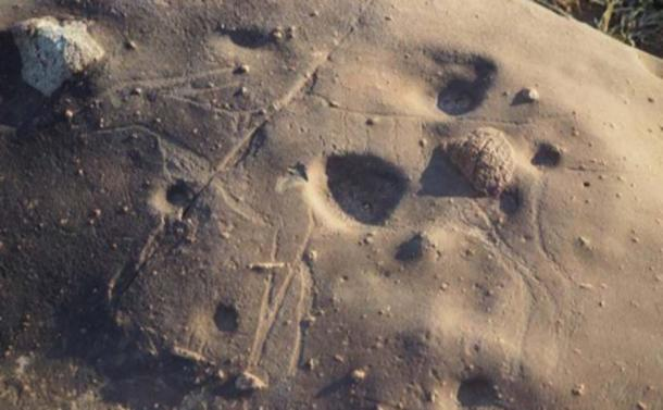 Look closely and the faint carving of an antelope emerges from the rock here. (Dr. Matthew Huber / University of the Free State)