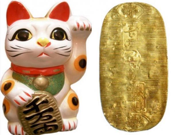 Left, a Maneki Neko or Lucky Cat and a Koban coin