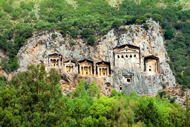 Lycian tombs carved into the face of a cliff in Turkey.