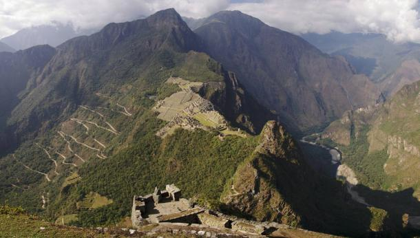 Machu Picchu and mountains and Inca roads seen from Wayna Picchu ruins. (Armando Frazão /Adobe Stock)