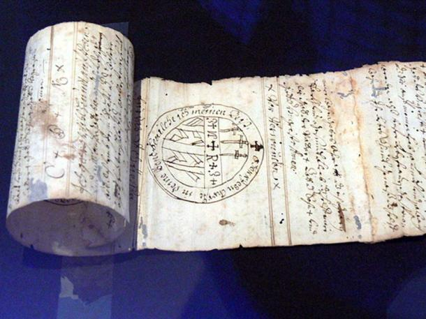 Magic words and signs on a rolled strip of paper (18th century). Upper Austrian County Museum