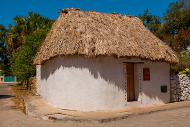 Many Maya on Mexico's Yucatan Peninsula still dress, cook and live as their relatives have for millennia. A traditional home in Yucatan. Credit: Anna ART / Adobe Stock