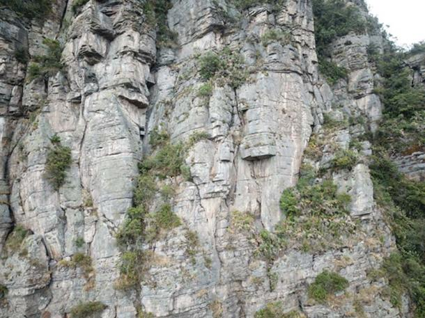 Many possible faces are visible in the cliff faces of Peña de Juaica