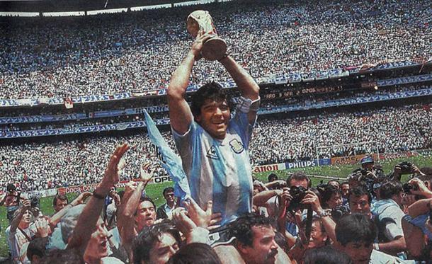 Maradona raises the World Cup for Argentina in 1986. (Public Domain)