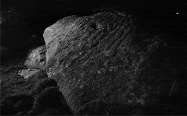 Marks on the rock came into view under a camera flash and would have lit up in moonlight Credit: Dr Andy Jones