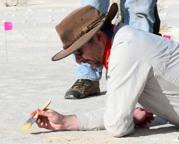 Matthew Bennett, dusting for prints. David Bustos, National Park Service