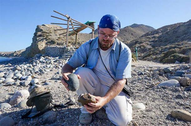 Matthew Des Lauriers turns a beach cobble into a stone tool like one used by people who lived on Cedros Island nearly 13,000 years ago