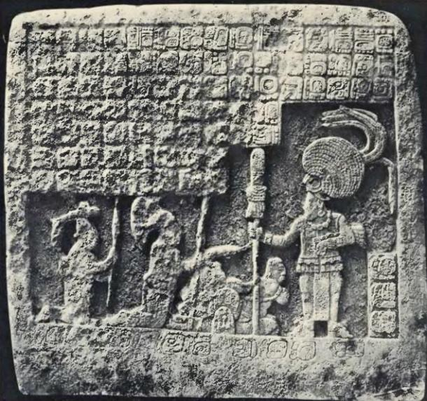 A Maya ruler at right takes obeisance from some supplicants.