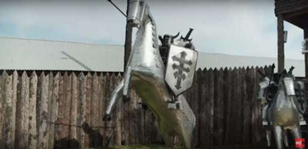 Medieval Knights made from old washing machines guard the site (ODN / YouTube Screenshot)