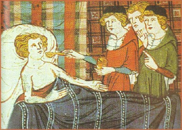Medieval illustration of a man being given medicine