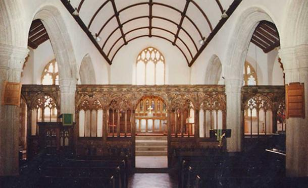 Medieval screen in St Winwaloe's Church, East Portlemouth. It includes a depiction of St Cornelius, perhaps a distant echo of a local tale of Corineus