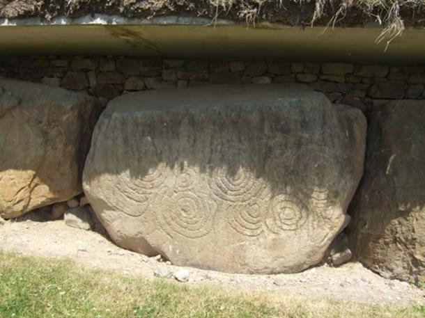 Megalithic carved stone at Knowth featuring a series of incised spiral markings.