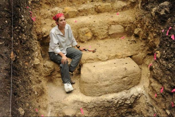 University of Arizona graduate student Melissa Burham works at a stone monument placed just before the Preclassic collapse in the 2nd century.