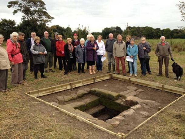 Members of Rainhill Civic Society and Merseyside Archaeological Society with the repaired holy well.