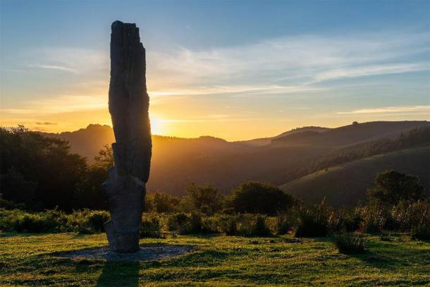 Menhir of Arlobi at sunset, Gorbea Natural Park, Alava, Spain. (Noradoa /Adobe Stock)
