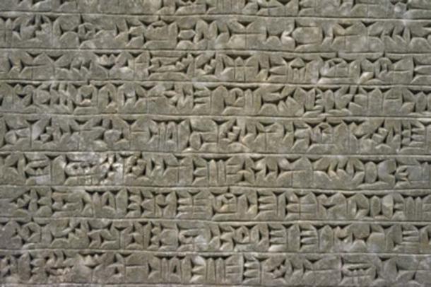 Mesopotamian relief 865-860 BC, showing cuneiform script. (bennnn / Adobe Stock)