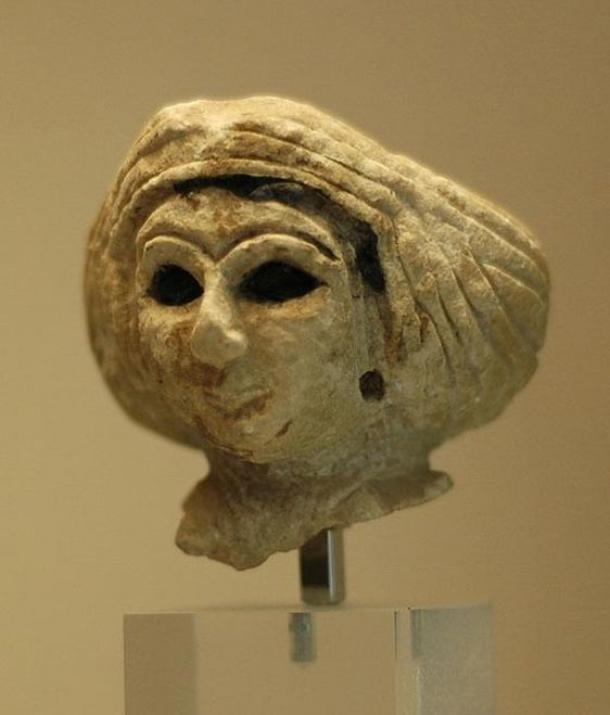 Head of a Mesopotamian woman wearing a turban.