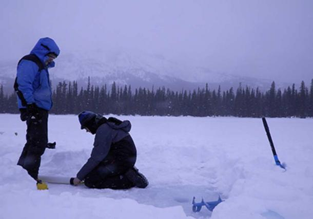 Mikkel W. Pedersen and colleague preparing for coring of the lake sediments.