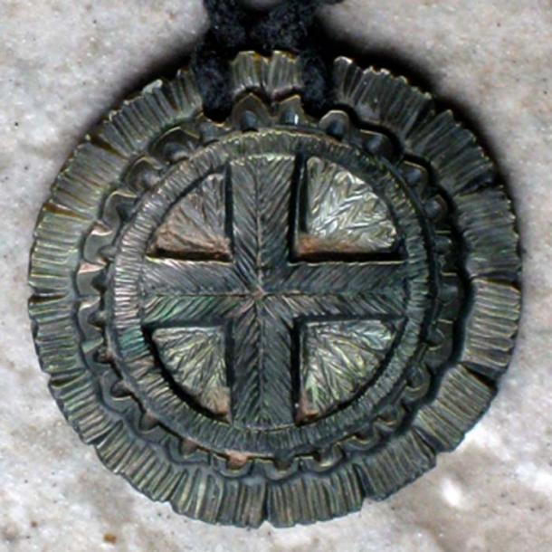 Miniature contemporary, cross-in-circle gorget by Dan Townsend (Muscogee Creek-Cherokee), Florida. (Public Domain)