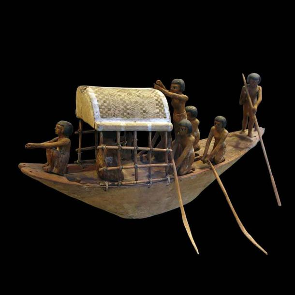 An ancient Egyptian miniature boat from 2000 BC that appears to be an ancient toy but was in fact a representation of crossing the waters to the other side. But toy boats were probably also playthings in Egypt, but maybe we'll never know for sure. (Rama / CC BY-SA 3.0).