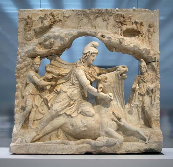 Marble relief of a Mithraic tauroctony scene from the Capitol, Rome, Italy, of the Roman cult figure of Mithras sacrificing a bull.