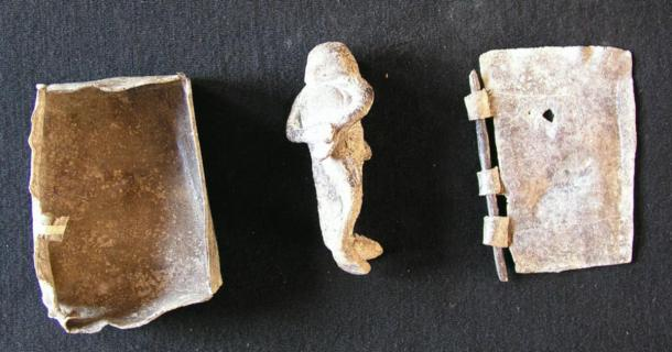 Model sarcophagus and figurine made of lead, found at the bottom of the Kerameikos well, 5th century BC. (Dr. Jutta Stroszeck / German Archaeological Institute)
