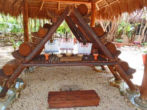 Modern Maya bee keeping facility, with traditional log hives.