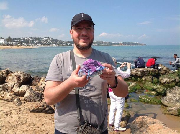 Mohamed Ghassen Nouira holding examples of his ancient purple dye (Mohamed Ghassen Nouira)